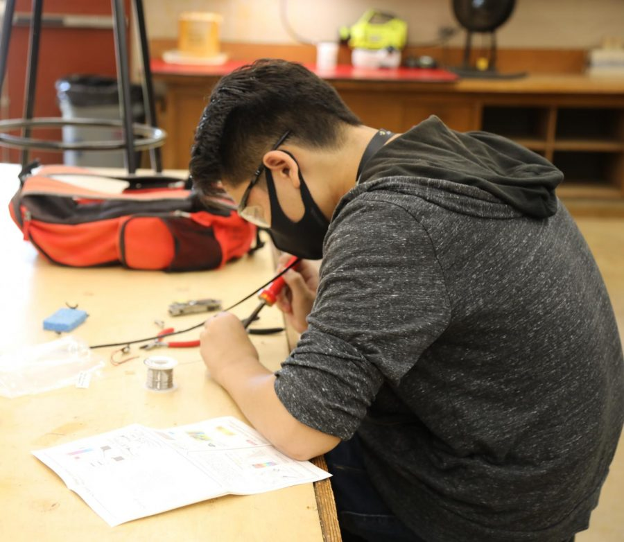 With the new hybrid schedule, students like senior Chansen Tano (above) resume hands-on  activities on campus after three quarters of virtual learning.