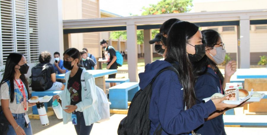 Students leave the cafeteria with lunch, which is provided to all students at no cost this year.